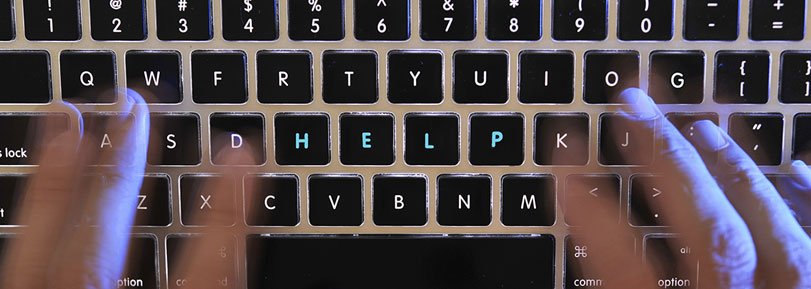 "Keyboard with the word ""help"" highlighted."
