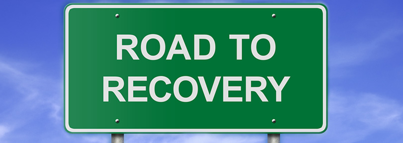 "Road sign that says, ""Road to Recovery""."