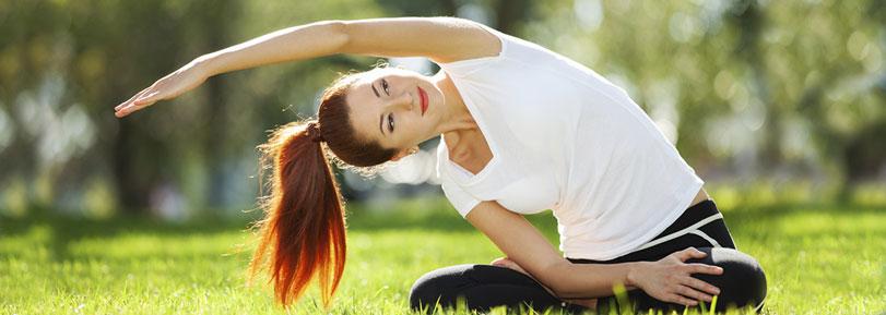 Girl doing yoga in the park.