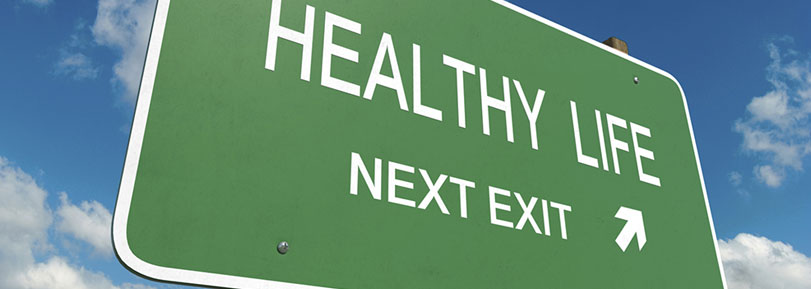 "Road sign that reads: ""Healthy Life, Next Exit""."
